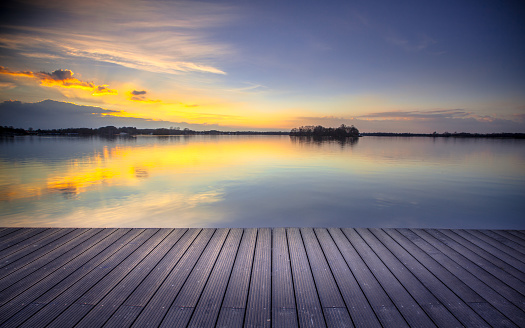 istock Patio view over lake at sunset  ready for product montage 858396348