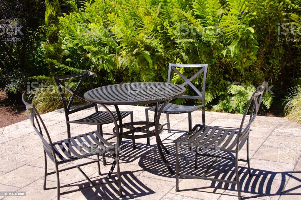 A garden patio with outdoor patio furniture.
