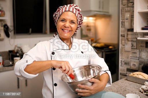 Woman patissier preparing sweets.