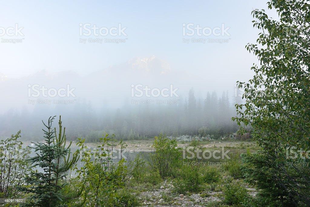 Patricia Lake on foggy day with Pyramid Mountain stock photo