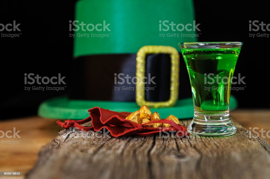 Patrick day green drink, leprechaun hat and gold prills stock photo