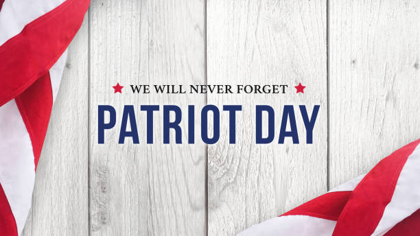Patriot Day - We Will Never Forget Text Over White Wood stock photo