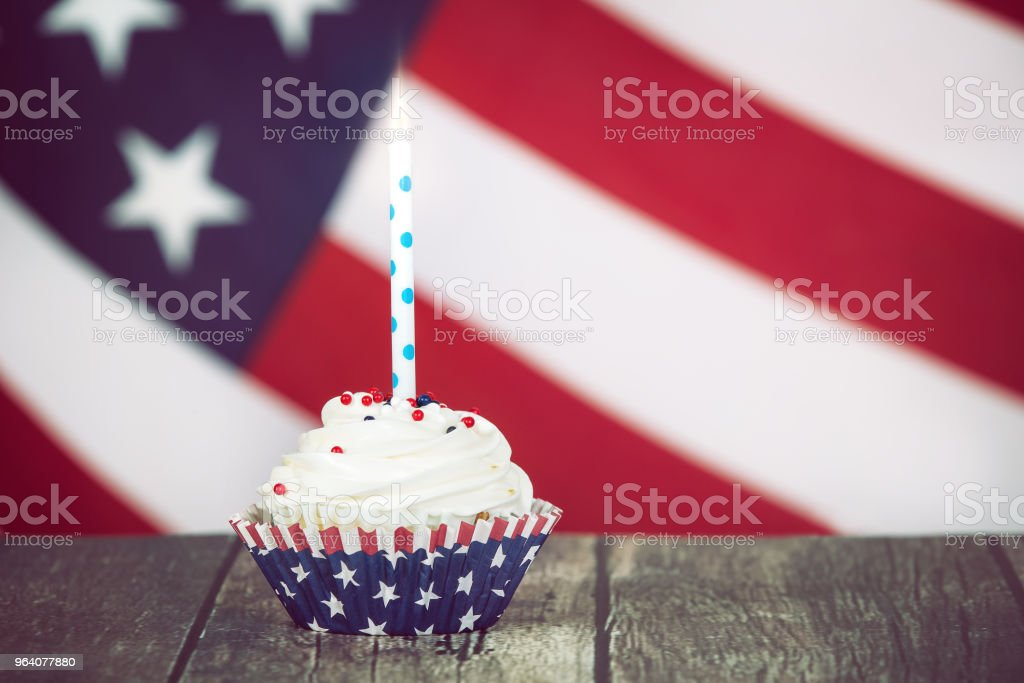 Patriotic 4th of July celebration cupcake with a candle - Royalty-free American Flag Stock Photo