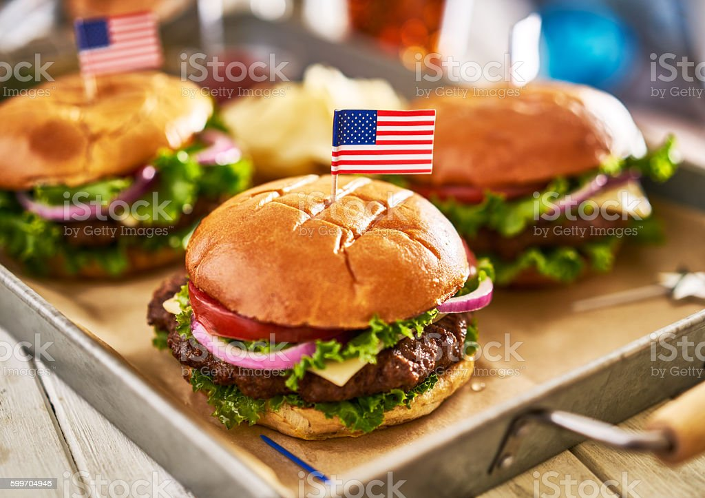 patriotic american cheese burges with flags on tray stock photo