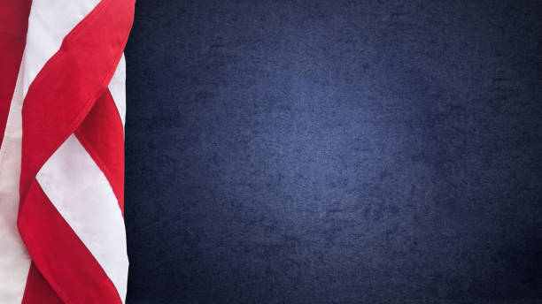 Patriotic American Flag and Blue Texture with Copy Space, United States Holiday and Election Background Patriotic American Flag and Navy Blue Texture with Copy Space, United States Holiday and Presidential Election Background us president stock pictures, royalty-free photos & images