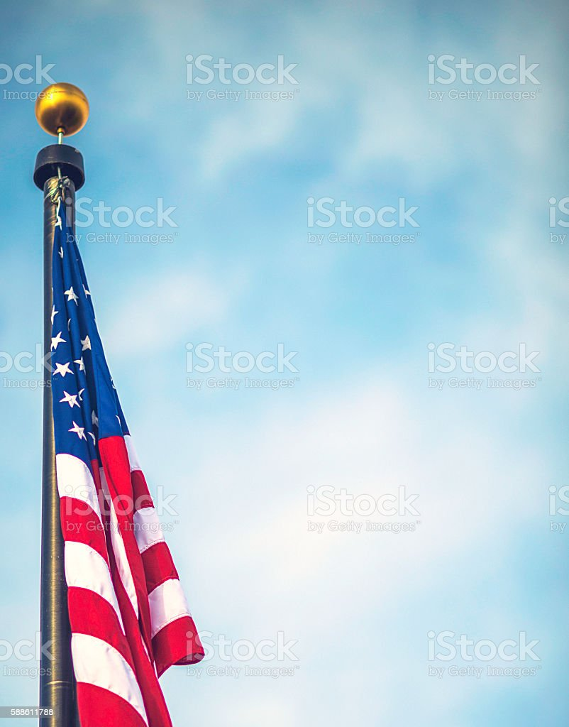Patriotic American flag background with sky and clouds stock photo