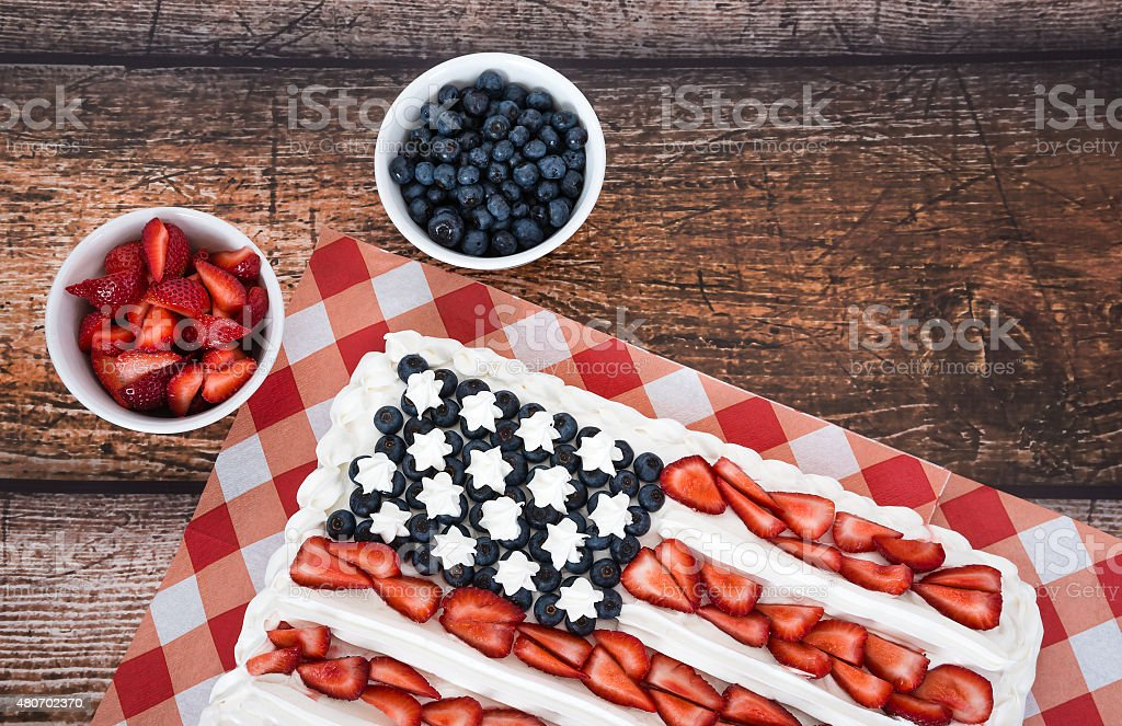 Patriotic American flag cake with blueberries and strawberries stock photo