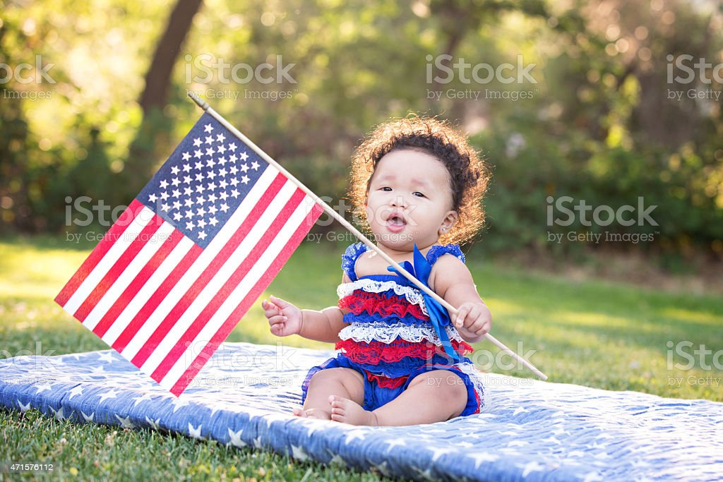 Patriotic Baby Girl Waving American Flag stock photo