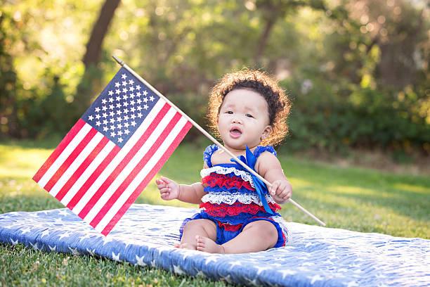 Patriotic Baby Girl Waving American Flag stock photo