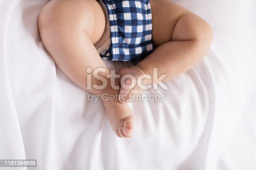 3-month old baby bum, legs, toes and feet. USA patriotic themed photos. Red, White and Blue.
