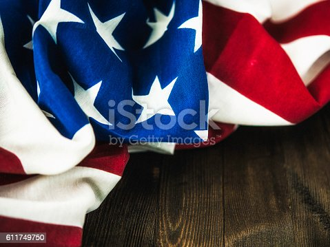 612818918 istock photo Patriotic backgrounds. American flag on wood table for US holidays 611749750