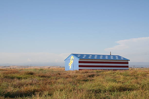 """Patriotic Barn Barn Painted Like an American Flag with a """"support our troops"""" ribbon. war effort stock pictures, royalty-free photos & images"""