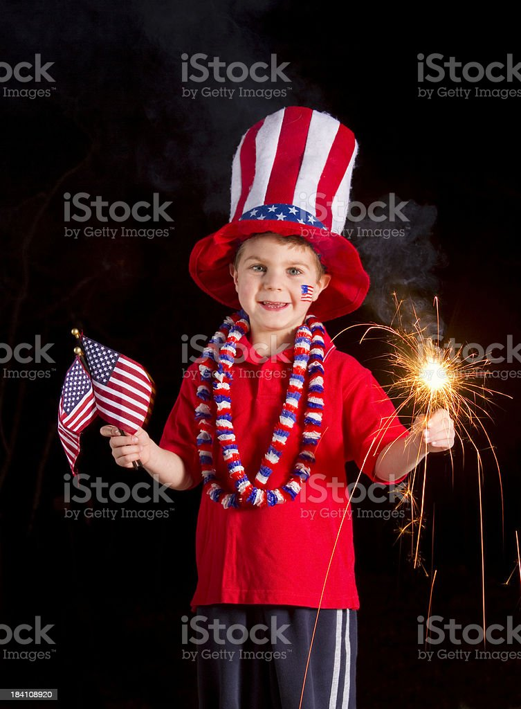 Patriotic Boy Holding Fourth Of July Sparkler & Flags royalty-free stock photo