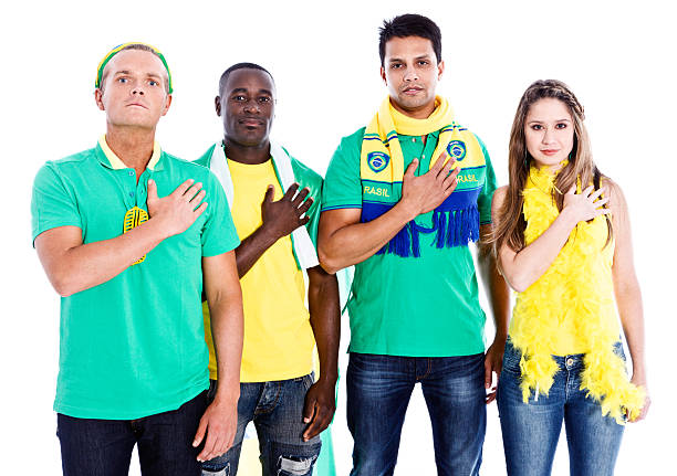 patriotic brazilian sports fans pledging allegiance - national anthem stock photos and pictures