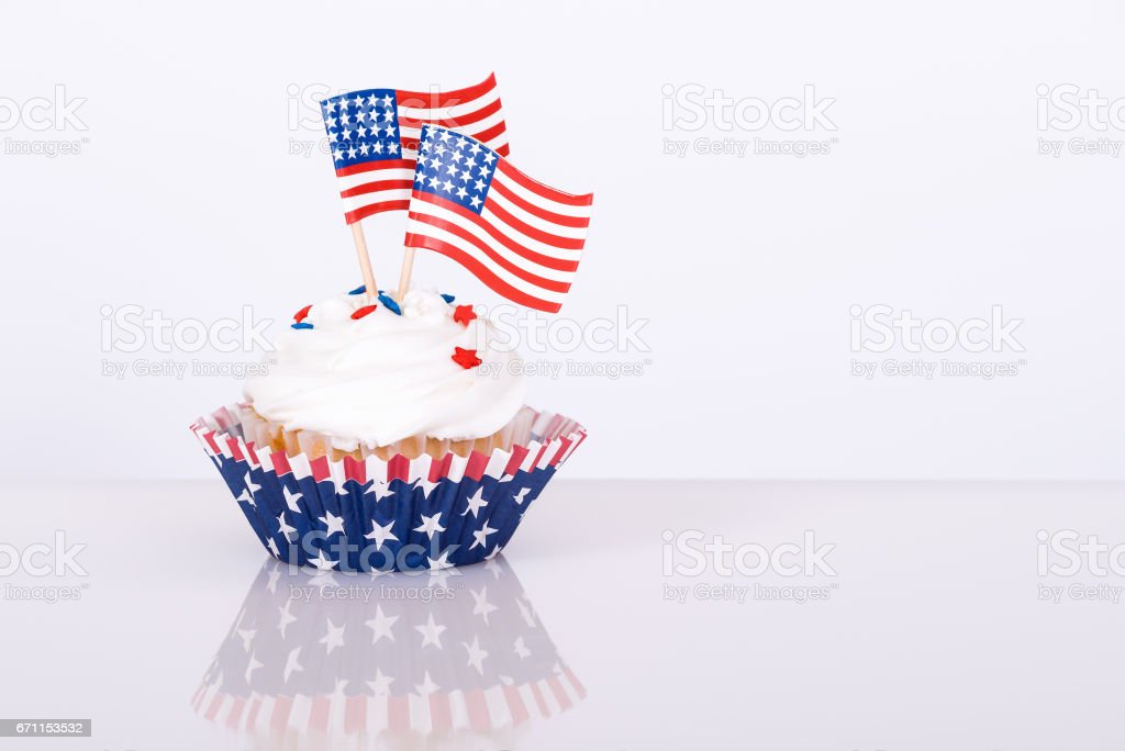Patriotic cupcake with decorative American flags stock photo
