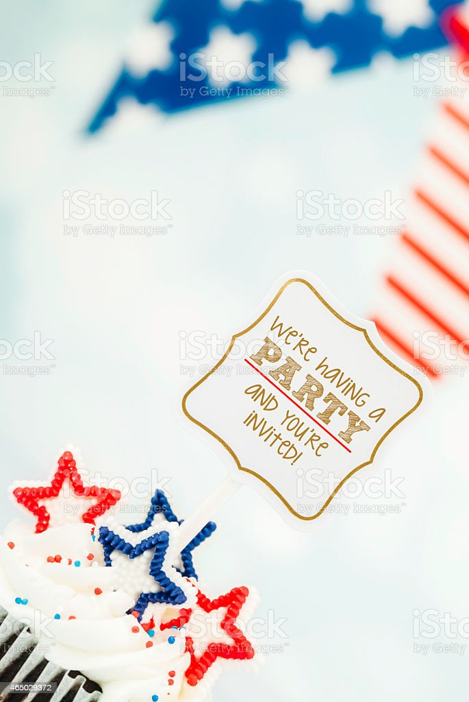 Patriotic cupcake with party invitation. July 4th and birthday celebrations. stock photo