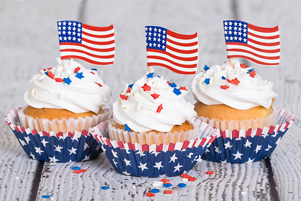 Patriotic cupcakes with sprinkles and American flags stock photo
