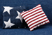 Patriotic cushions on denim fabric background