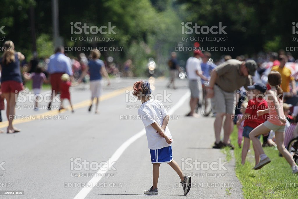 Patriotic Dyed Hair Boy Waiting for July 4th Parade stock photo