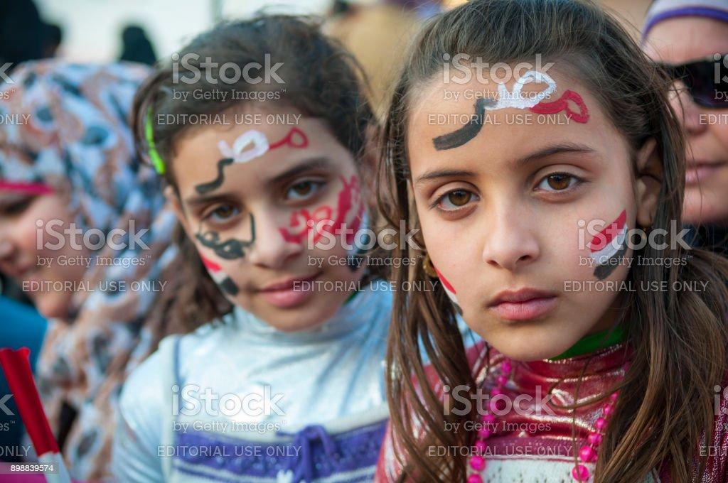 Patriotic Egyptian girls in Cairo's Tahrir Square stock photo