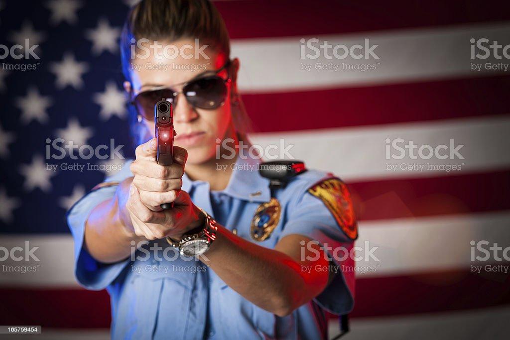 Patriotic Female Police Officer Aiming Handgun stock photo