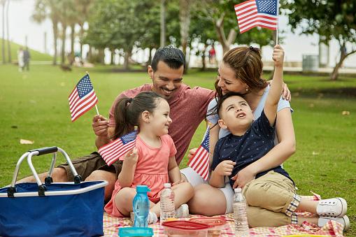 Patriotic Hispanic Family Picnicking at Miami Public Park