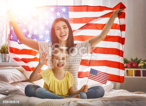 539482224 istock photo Patriotic holiday and happy family 539480616