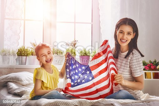 539482224 istock photo Patriotic holiday and happy family 539480842