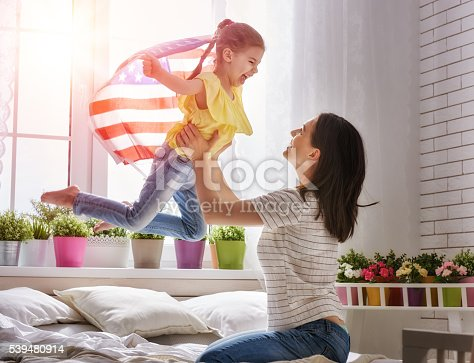 539482224 istock photo Patriotic holiday and happy family 539480914
