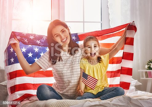539482224 istock photo Patriotic holiday and happy family 539481014