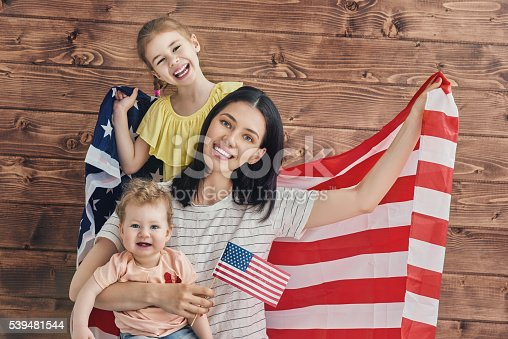539482224 istock photo Patriotic holiday and happy family 539481544