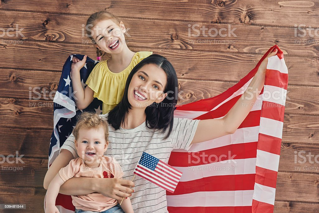 Patriotic holiday and happy family stock photo