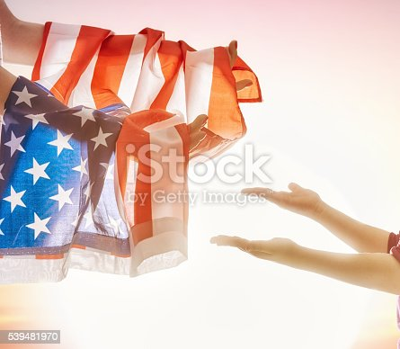 539482224 istock photo Patriotic holiday and happy family 539481970