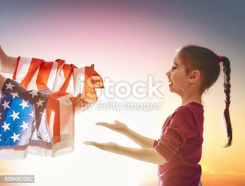 539482224 istock photo Patriotic holiday and happy family 539482052