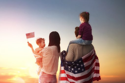 istock Patriotic holiday and happy family 539482224