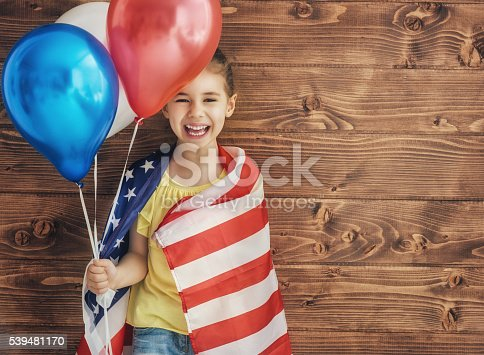 539482224 istock photo Patriotic holiday and happy kid 539481170