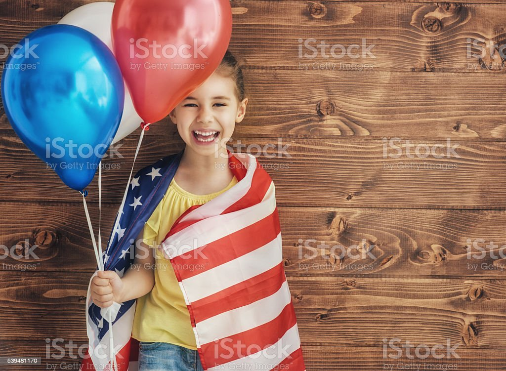 Patriotic holiday and happy kid stock photo