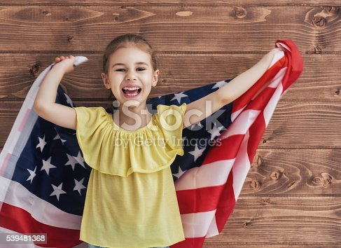 539482224 istock photo Patriotic holiday and happy kid 539481368