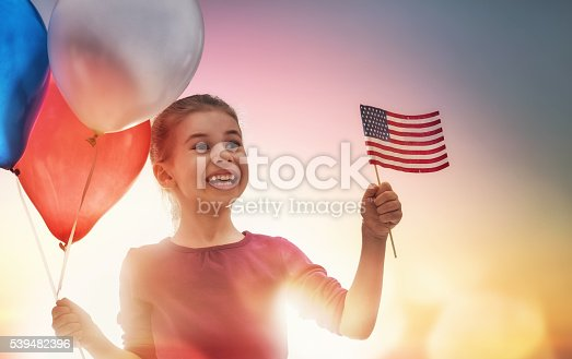 539482224 istock photo Patriotic holiday and happy kid 539482396
