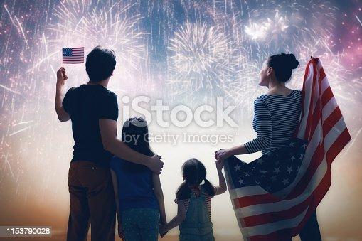 539482224istockphoto Patriotic holiday. Happy family 1153790028