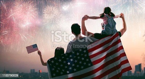 539482224istockphoto Patriotic holiday. Happy family 1153790029