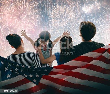 539482224istockphoto Patriotic holiday. Happy family 1153790031