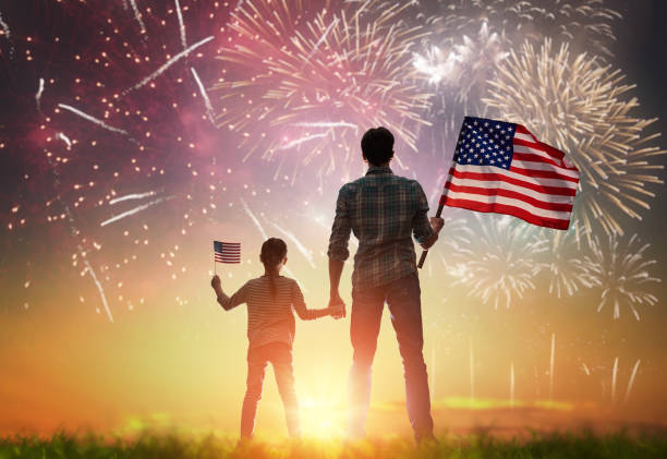 Patriotic holiday. Happy family Patriotic holiday. Happy kid, cute little child girl and her father with American flag. USA celebrate 4th of July. family 4th of july stock pictures, royalty-free photos & images