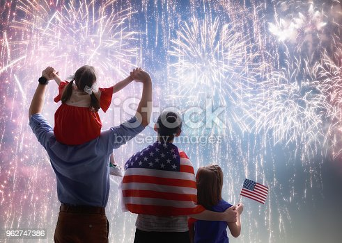 539482224istockphoto Patriotic holiday. Happy family 962747386