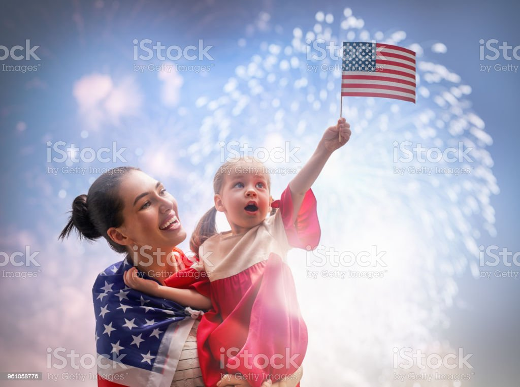 Patriotic holiday. Happy family - Royalty-free Adult Stock Photo