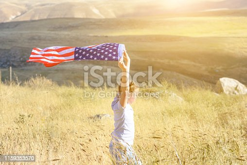 istock Patriotic holiday. Happy kid, cute little child girl with American flag. National 4 july. Memorial day. 1159353570