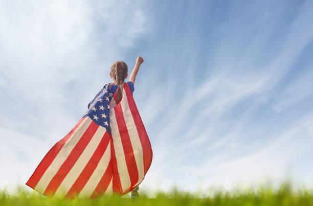 patriotic holiday. happy kid - baby super hero imagens e fotografias de stock