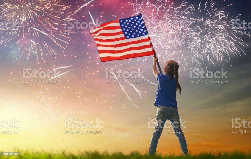 Patriotic holiday. Happy kid stock photo