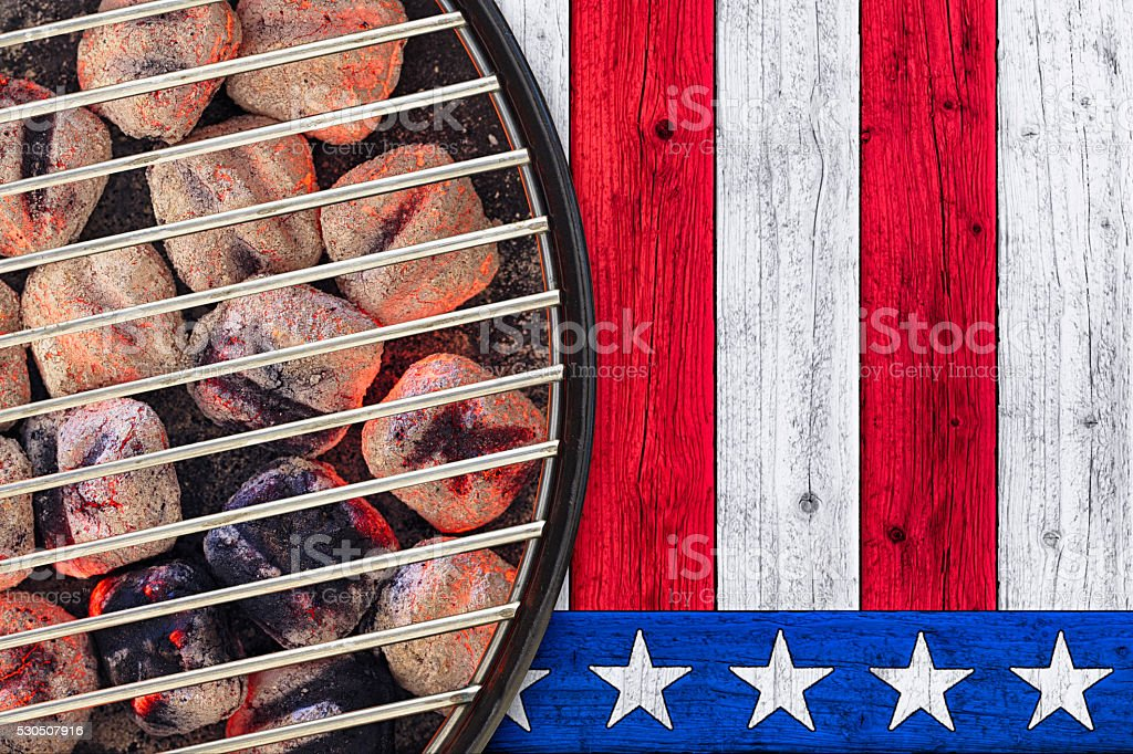 Patriotic Hot Grill with Glowing Briquettes stock photo