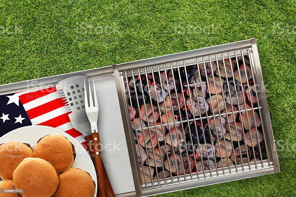 Patriotic Hot Grill with Platted Burgers on Lawn stock photo